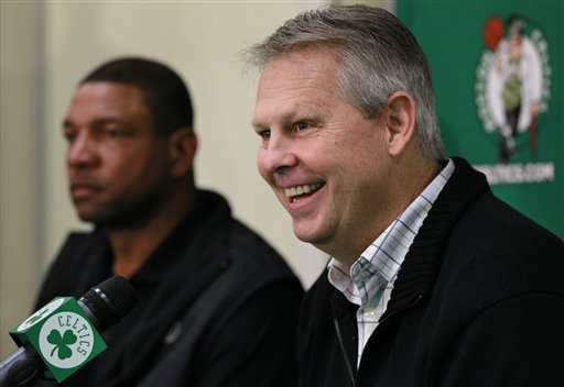 Boston Celtics Basketball Operations President Danny Ainge, right, and Celtics NBA basketball coach Doc Rivers, left, face reporters at the teams practice facility during a news conference, in Waltham, Mass., Thursday, Dec. 1, 2011. (AP Photo/Steven Senne)