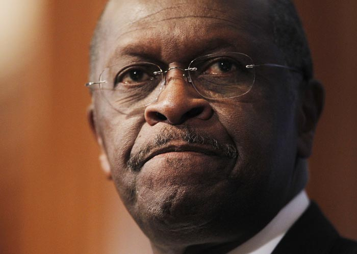 Republican presidential candidate, Herman Cain answers questions at the National Press Club in Washington, Monday, Oct., 31, 2011. Because of many sex-related allegations, Cain is considering ending his presidential run. (AP Photo/Pablo Martinez Monsivais)