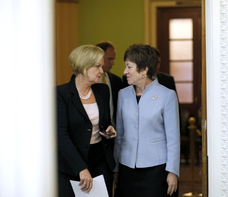 Sens. Susan Collins, R-Maine, right, and Claire McCaskill, D-Mo., head to a press conference Tuesday to unveil a bill to maintain a 2 percent payroll tax cut for 2012.