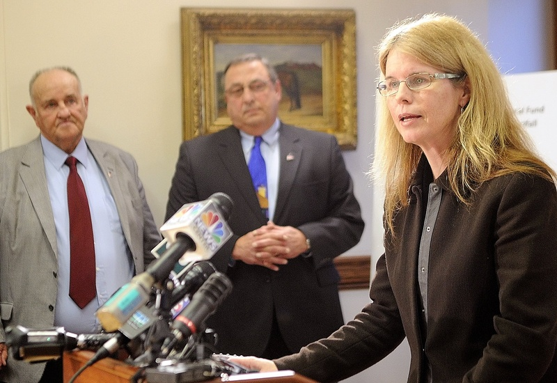 Mary Mayhew, the commissioner of the Department of Health & Human Services, right, said her team has been analyzing Medicaid numbers for months. Shown at left are H. Sawin Millett Jr., the commissioner of Administrative & Financial Services, and Gov. Paul LePage, during a news conference last week.