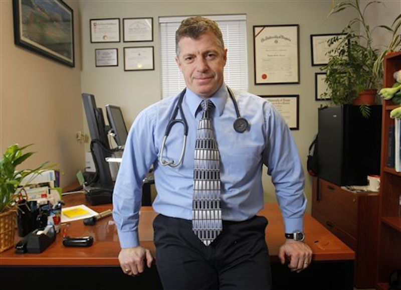 In this Dec. 16, 2011 photo, Dr. Doug Farrago poses in his office in Auburn, Maine. (AP Photo/Robert F. Bukaty)