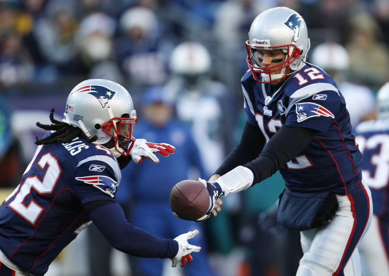 Patriots quarterback Tom Brady hands off to running back BenJarvus Green-Ellis against the Miami Dolphins on Saturday. The Patriots won 27-24.