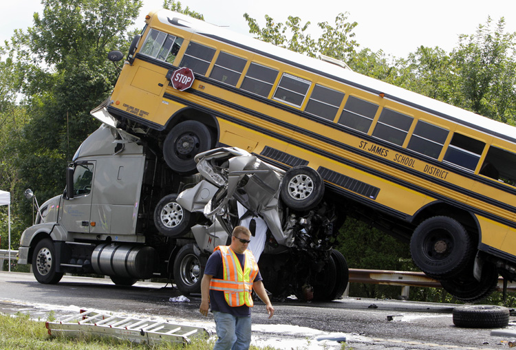 This Aug. 5, 2010, photo shows the scene of an accident involving two school buses, a tractor-trailer and another passenger vehicle, near Gray Summit, Mo. Federal safety investigators say a 19-year-old driver was texting at the time his pickup truck, two school buses and other vehicles collided in a deadly pileup on an interstate highway.