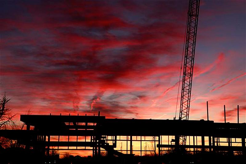 In this Nov. 25, 2011 photo, a commercial construction project is seen during sunset, at the Bala Cynwyd Shopping Center in Bala Cynwyd, Pa. The U.S. economy is ending 2011 on a roll. (AP Photo/Jacqueline Larma)