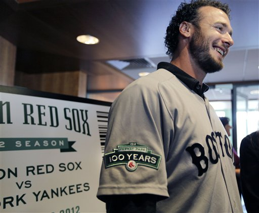 Boston Red Sox baseball catcher Jarrod Saltalamacchia chats with attendees of a news conference at Fenway Park in Boston Thursday, Dec. 8, 2011. Red Sox players will wear a patch on their uniform sleeve during the 2012 season to commemorate the 100th anniversary of Fenway Park, the oldest operating Major League Baseball park in the United States. (AP Photo/Elise Amendola)
