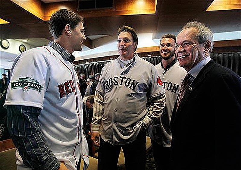 Boston Red Sox baseball president and CEO Larry Lucchino, far right, talks with catcher Ryan Lavarnway, left, hitting coach Dave Magadan, center, and catcher Jarrod Saltalamacchia at a news conference at Fenway Park in Boston on Thursday, Dec. 8, 2011. Red Sox players' uniforms for the 2012 season display a patch on the sleeves to commemorate the 100th anniversary of Fenway Park, the oldest operating Major League Baseball park in the United States. (AP Photo/Elise Amendola)