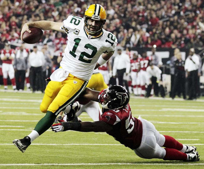 Green Bay Packers quarterback Aaron Rodgers scrambles past Atlanta Falcons linebacker Curtis Lofton during a divisional playoff game on Jan. 15, 2011.