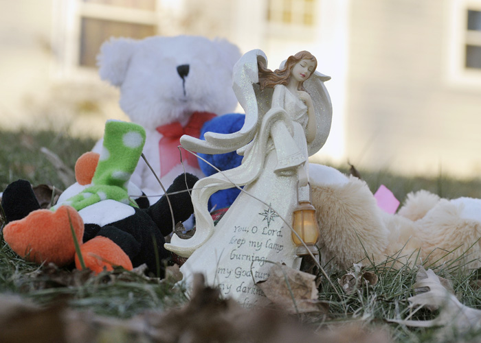 A collection of toys and mementos are placed on the lawn in front of the Waterville home where police and the FBI are investigating the disappearance of 20 month-old Ayla Reynolds.
