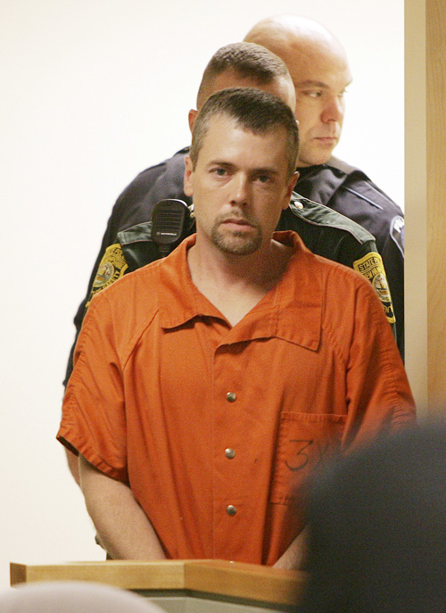 In this Nov. 10, 2010, photo, Christopher Smeltzer arrives for arraignment in District Court in Candia, N.H.