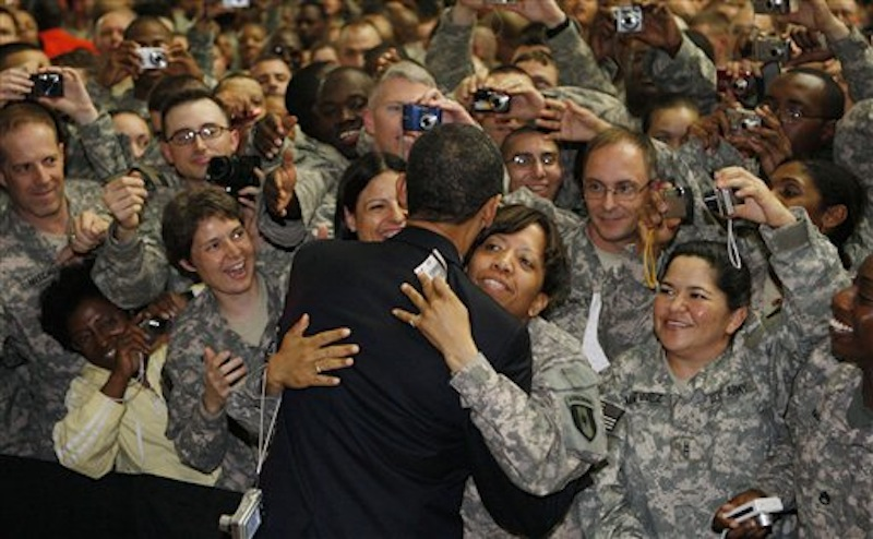 President Barack Obama hugs a soldier as he greets military personnel at Camp Victory in Baghdad, Iraq. On Friday, Dec. 2, 2011, the base that at its height was home to 46,000 people was handed over to the Iraqi government as America ended the war. (AP Photo/Charles Dharapak)