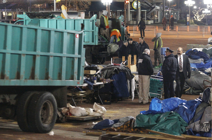 Sanitation workers remove debris from McKeldin Square in Baltimore after police evicted Occupy protesters this morning.