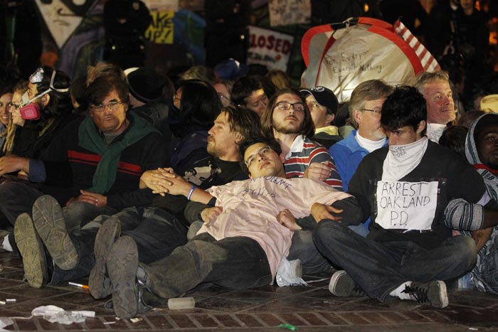 Protesters wait to be arrested as Los Angeles police begin clearing the Occupy LA encampment outside City Hall in Los Angeles on Wednesday.