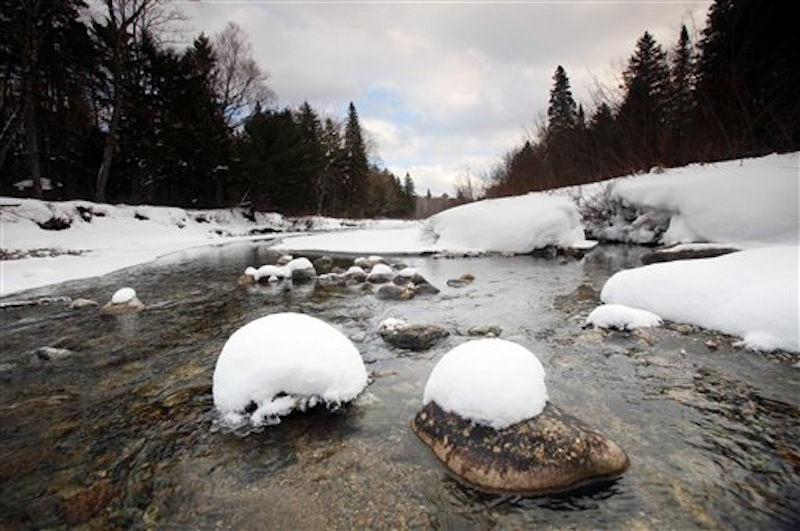 In this Jan 28, 2011 file photo, Wassataquoik Stream flows through Township 3, Range 8, Maine, on land owned by Roxanne Quimby, the founder of Burt's Bees cosmetics company. Quimby has offered to donate a 70,000-acre parcel she owns to create a national park adjacent to the state's Baxter Park. But former state Senate president Charles Pray wants a study that looks beyond the scope of a national park's possible impacts on tourism and looks at its broader implications. (AP Photo/Robert F. Bukaty, File)