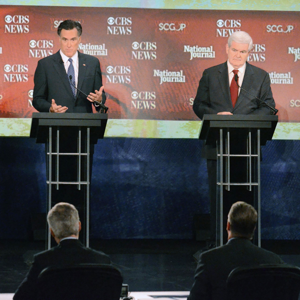 Republican presidential candidates Mitt Romney, left, and Newt Gingrich answer questions on Nov. 12 at the CBS News/National Journal foreign policy debate in Spartanburg, S.C.