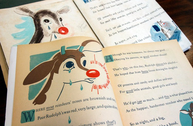 "A first edition of ""Rudolph, the Red-Nosed Reindeer,"" bottom, and an original layout, top, is part of a special collection at Dartmouth College."