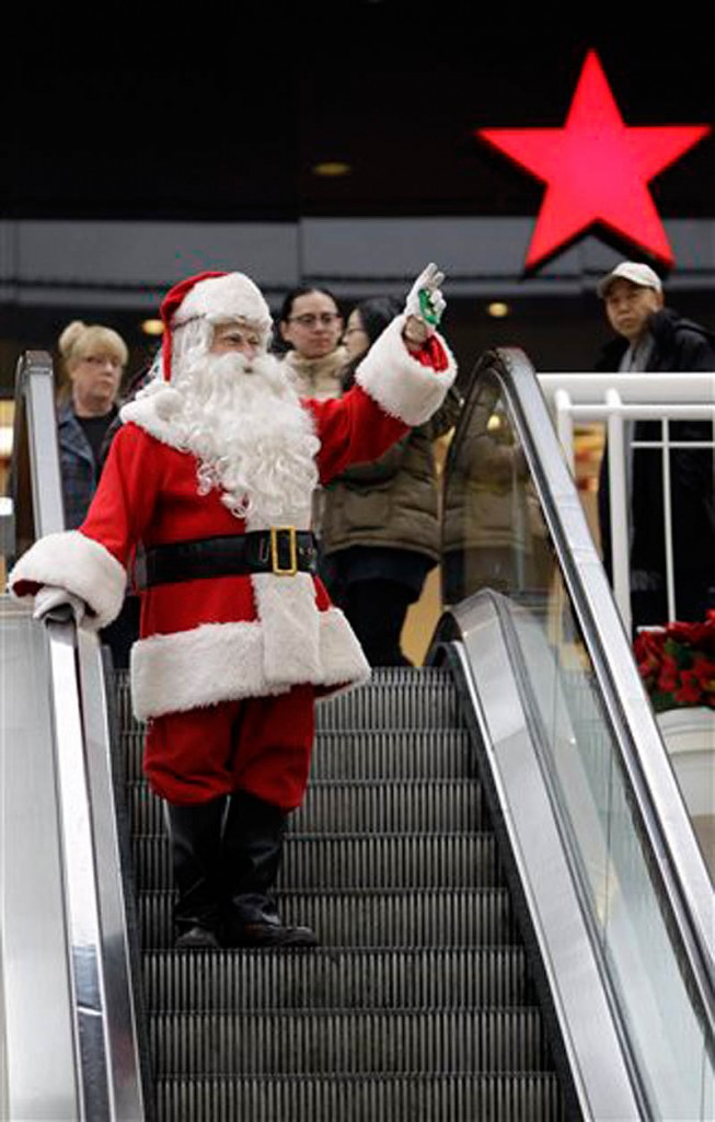 This Wednesday, Dec. 22, 2010 file photo shows Phil Martella dressed as Santa Claus as he arrives at a mall for seasonal photographs with children in Buffalo, N.Y. (AP Photo/David Duprey, File)