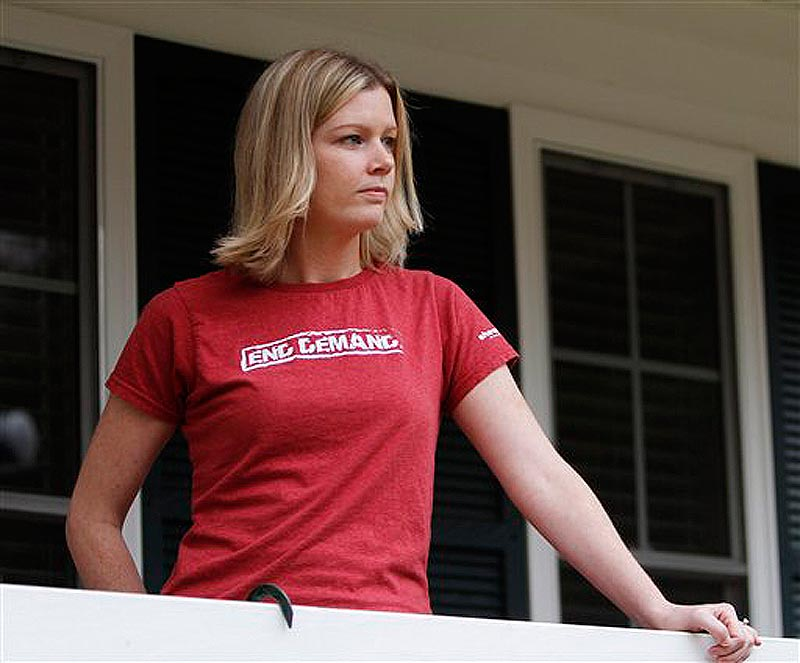 In this Tuesday, Nov. 22, 2011 photo, Holly Smith, 33, looks out form her porch after talking about her experiences when she was caught up in a child sex trafficking ring during an interview in her home in Richmond, Va. A new report says 41 states have failed to adopt strong penalties against human trafficking, and advocates say a patchwork of differing state laws makes it difficult for authorities to target the crime. Smith said a man at a mall promised her a job after she ran away from home at age 14. She said she was swiftly brought to a motel where two adults gave her a dress, put makeup on her face and dyed her hair. ìWithin hours I was on the streets of Atlantic City having men forced on me,î said Smith. (AP Photo/Steve Helber) Holly Smith