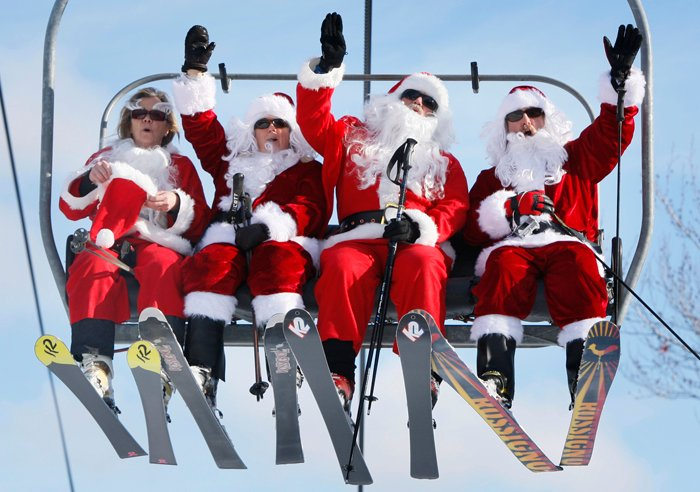 Some of the 250 Santas participating in a fundraiser today ride the chairlift at Sunday River Ski Resort in Newry.