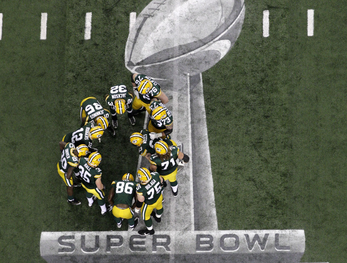 The Green Bay Packers gather on the field before the NFL Super Bowl XLV football game against the Pittsburgh Steelers on Feb. 6, 2011.