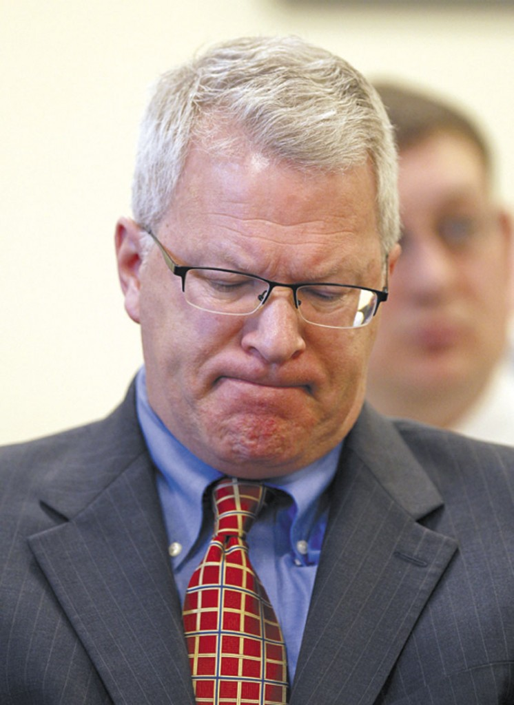 In this April photo, Paul Violette, former executive director of the Maine Turnpike Authority, grimaces before appearing before the Legislature's Government Oversight Committee in Augusta.