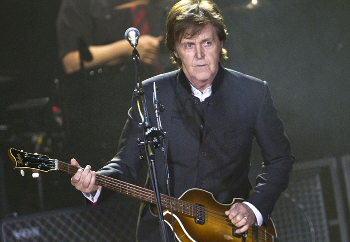 In this Dec. 5, 2011, photo, Sir Paul McCartney performs in London during his European tour, his first since 2004.
