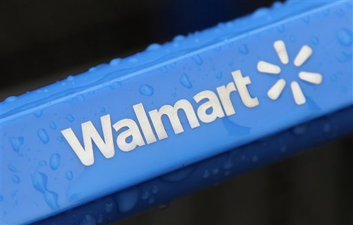 This photo taken Nov. 14, 2011, shows the rain-soaked handle of a shopping cart outside the Wal-Mart store in Mayfield Hts. Wal-Mart has pulled a batch of powdered infant formula from more than 3,000 of its stores nationwide after a newborn Missouri boy who was given the formula died. (AP Photo/Amy Sancetta, File)
