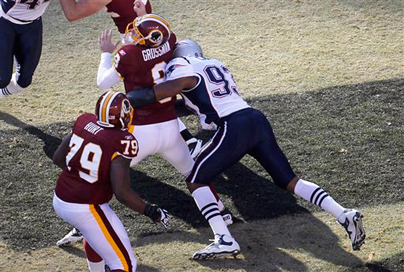 Washington Redskins quarterback Rex Grossman (8) is sacked in the end zone by New England Patriots defensive end Andre Carter during the first half of an NFL football game, Sunday, Dec., 11, 2011 in Landover, Md. (AP Photo/Pablo Martinez Monsivais)