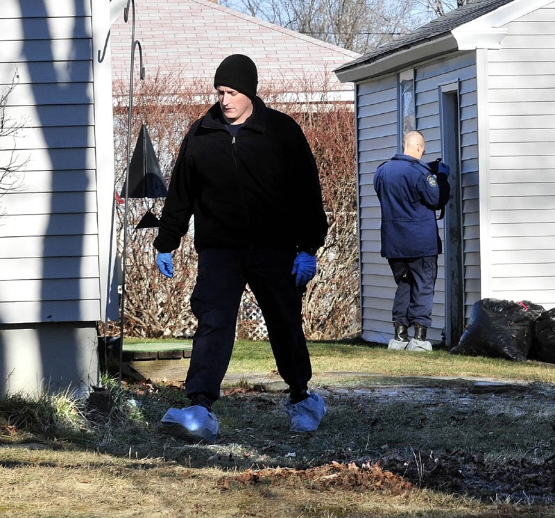 LOOKING FOR CLUES: Maine State Police investigators look for clues at the home and garage at 29 Violette Ave. in Waterville on Tuesday where 20-month-old Ayla Reynolds lived and disappeared last Friday.