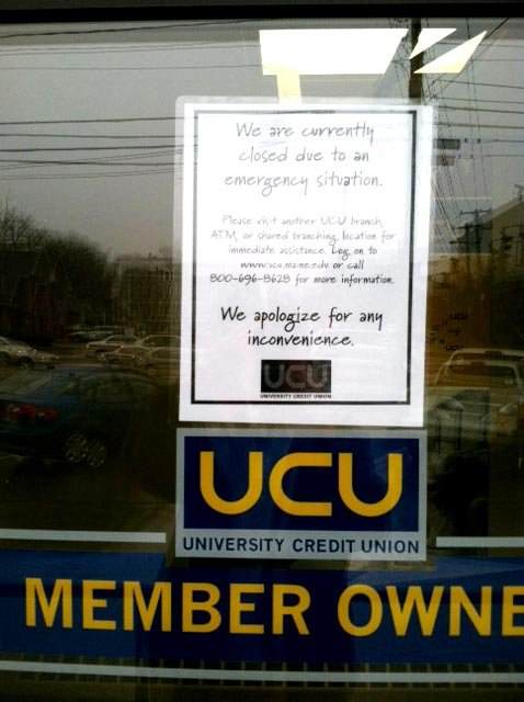 A closed sign appears on the door of University Credit Union following a robbery today.