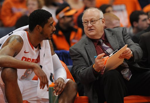 This Nov. 12, 2001 photo shows former Syracuse assistant basketball coach Bernie Fine talking to Fab Melo on the bench during a game against Fordham, in Syracuse, N.Y. The district attorney said on Wednesday, Dec. 7, 2011, he cannot bring charges against Fine because the statute of limitations has passed.