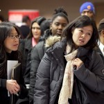 People wait to talk with potential employers at a job fair in New York sponsored by National Career Fairs. Research shows more people are going back to school to hone their job skills.