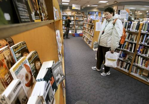 """Stephanie Berry of Portland shops at Longfellow Books in Portland. The bookstore supports the city's """"buy local"""" effort."""