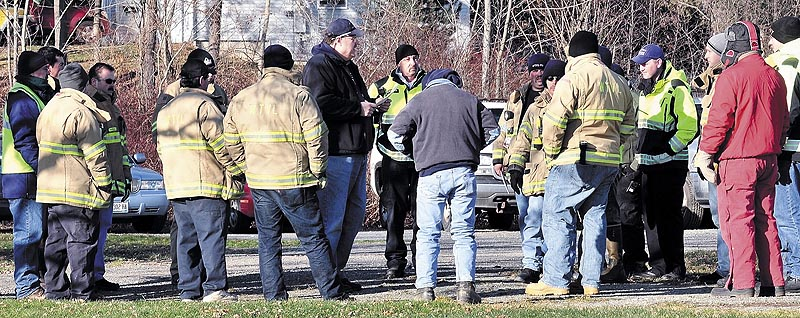Staff photo by David Leaming COMMAND: Waterville Fire Chief Dave LaFountain, center, direct firefighters before an extensive search Sunday for missing 20-month-old Ayla Reynolds near her home on Violette Avenue in Waterville.