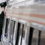 A conductor keeps watch as the Amtrak Downeaster arrives in Portland, Maine, Friday, Dec. 14, 2007. The Downeaster is celebrating its 10th birthday. (AP Photo/Robert F. Bukaty)