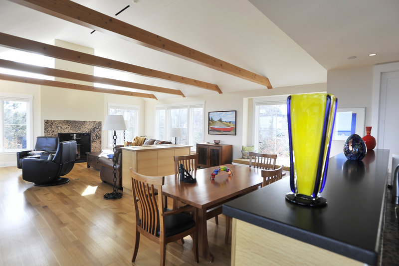 The third floor includes a combined kitchen, dining and living space, with windows on three sides.