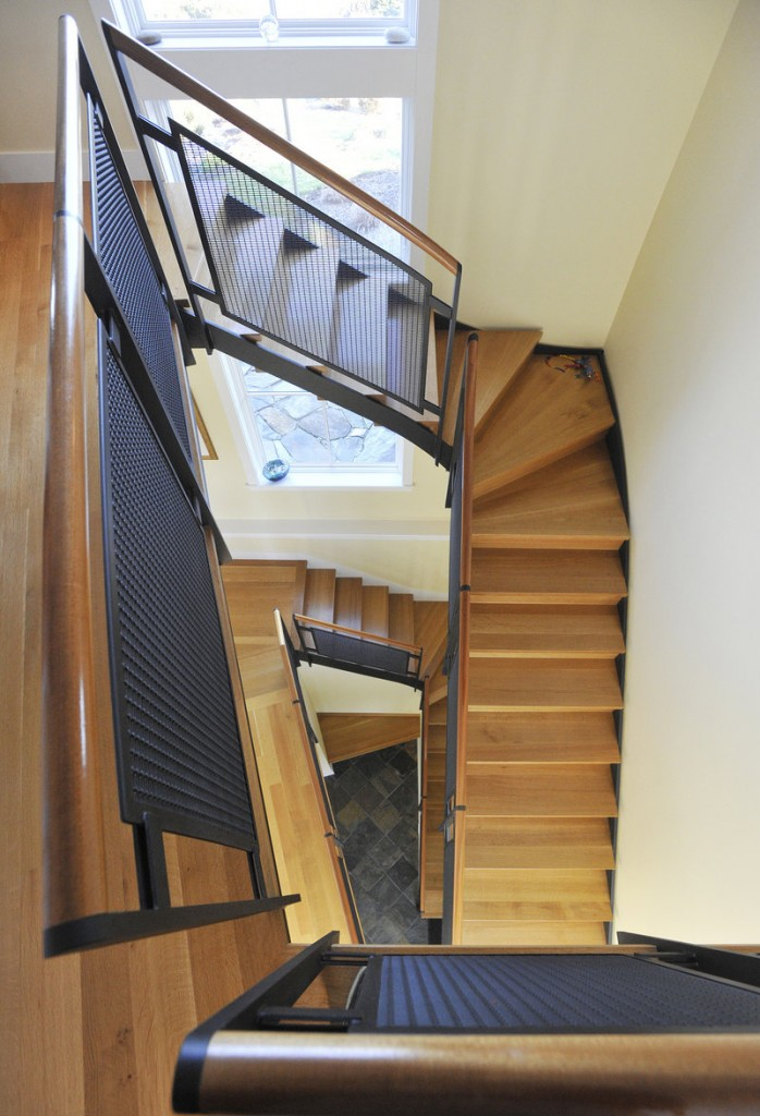 The wood and steel staircase is central to the Grays' home.