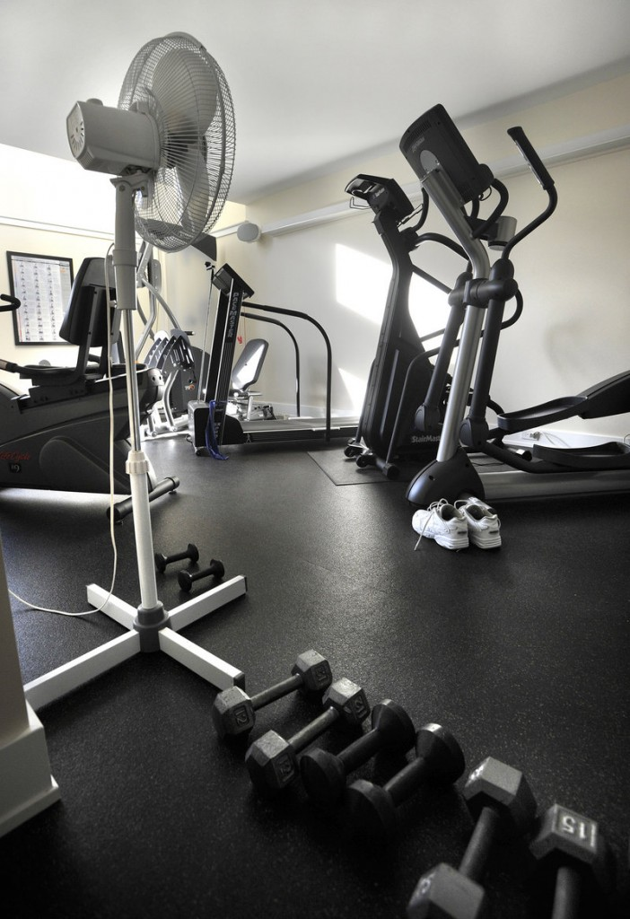 The first floor contains office and storage space and a home gym.