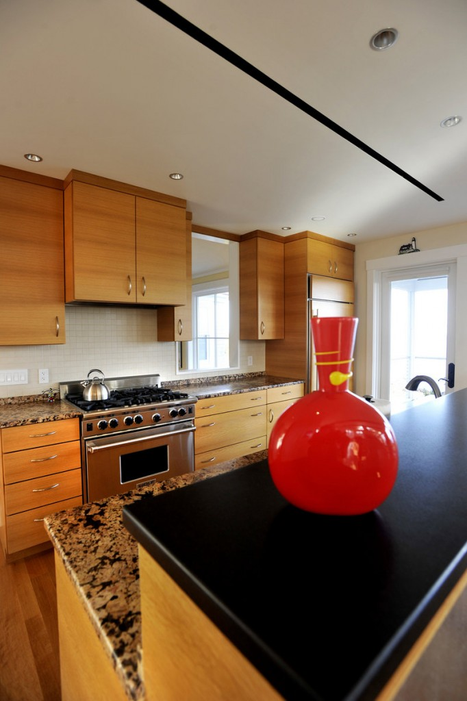 The kitchen features custom wood cabinets and granite countertops.