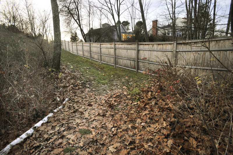 Chris McCormick's fence runs alongside an easement that provides access to the water. Neighbors say McCormick moved the trail, making it more difficult to navigate.