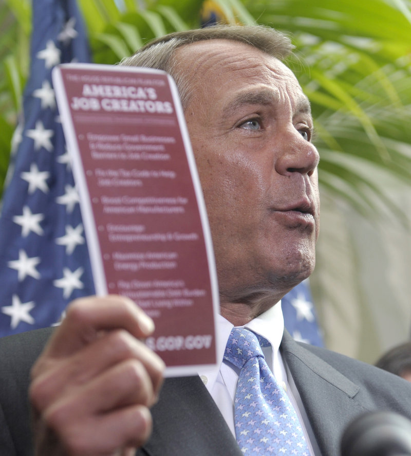 "House Speaker John Boehner, R-Ohio, holds a document labeled ""America's Job Creators"" while talking to the media after a Capitol Hill meeting Wednesday."