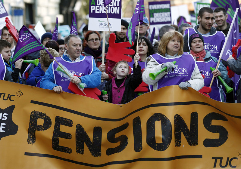 Marchers protested in Manchester, England, Wednesday, joining what unions estimated were as many as 2 million public sector workers for the largest strike in decades.