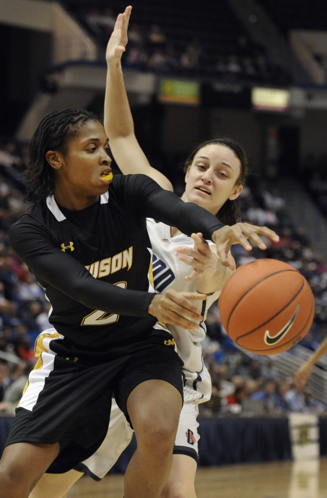 Deree Fooks of Towson tries to get a pass off Wednesday night while defended by Kelly Faris of Connecticut during the first half of second-ranked UConn's 92-31 victory.