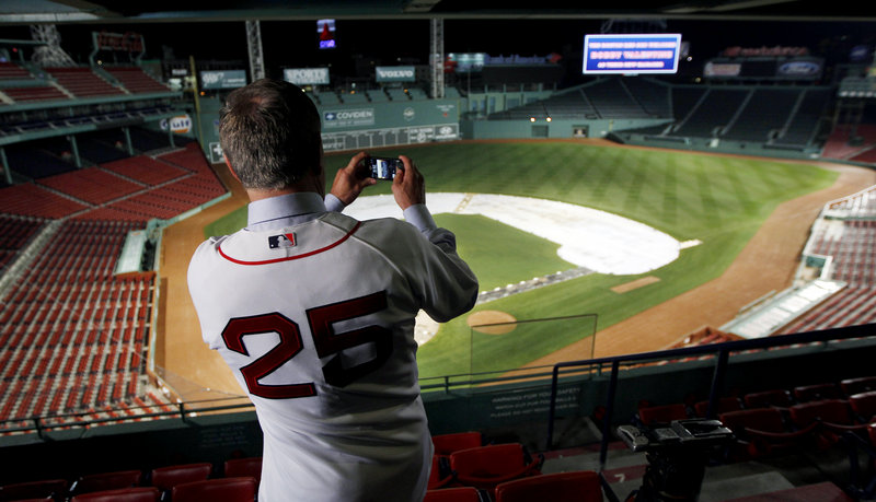 Bobby Valentine uses his phone to take a picture of Fenway Park after Thursday's press conference. Valentine has 15 years of managerial experience with the Rangers and Mets, but hasn't managed in the majors since 2002.