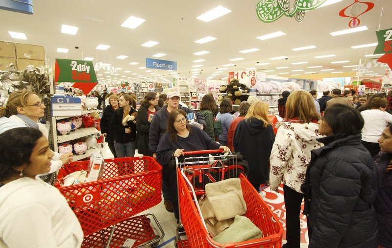 Black Friday shoppers navigate the crowded aisles at Target in South Portland shortly after the doors opened last year.