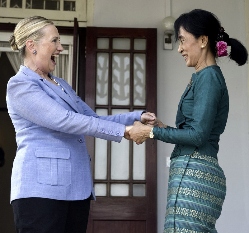 Myanmar's pro-democracy opposition leader Aung San Suu Kyi, right, and Secretary of State Hillary Rodham Clinton hold hands after meeting in Yangon, Myanmar, on Friday.