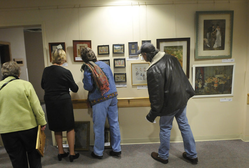 "People look over Goodwill Industries of Northern New England's sixth biannual ""Art for Everyone: A Collection of Donated Art,"" on Friday."