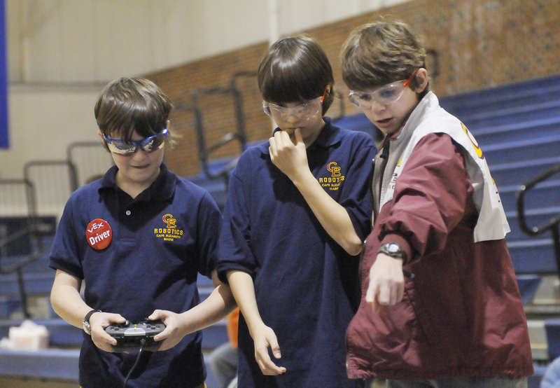 Mac Brucker, Sam Price and Will Corsello of Cape Elizabeth, left to right, operate their robot during competition at the Southern Maine VEX Tournament on Saturday. Even when teams don't win, participants gain knowledge to use at next year's competition, fans say.