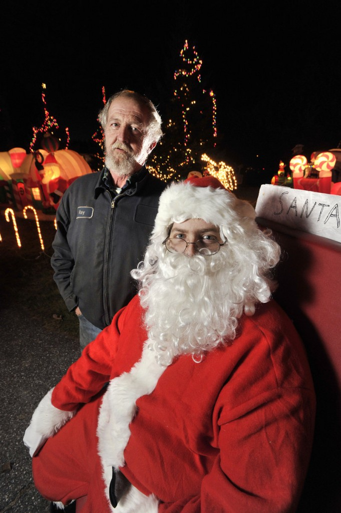 The yard in front of the home of Ray, left, and Mary Benner on Austin Street in Westbrook is aglow with lighted, inflatable Christmas decorations and also features Santa Claus for those who stop by to see the display.