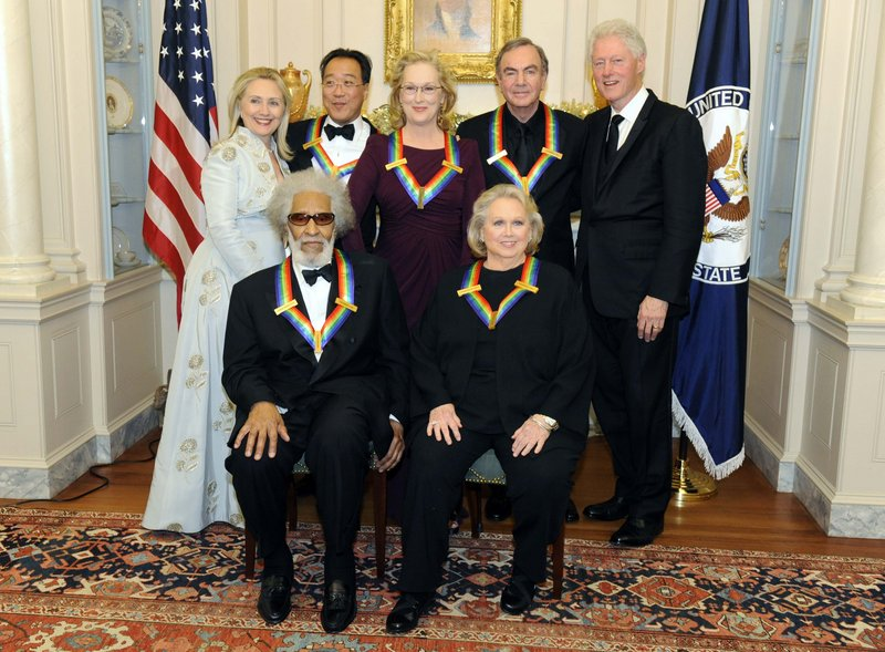 Secretary of State Hillary Clinton, left, and former President Clinton pose with the 2011 Kennedy Center honorees – front, Sonny Rollins, left, and Barbara Cook, and back, Yo-Yo Ma, left, Meryl Streep and Neil Diamond – after a dinner and reception Saturday.