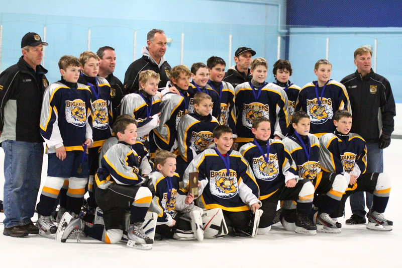 The Southern Maine Breakers Pee Wee hockey team won the Cornucopia Cup Tournament on Thanksgiving weekend at the Ice Center in Salem, N.H. The Breakers went 3-1-1, including a 7-4 win over Triboro of Massachusetts in the championship game. Team members, from left to right: Front – Lucas Roop, Owen Sullivan, Brandon Wasser, Logan Magnant, Justin Perry and Derek Muse; Second row – Johnny Korpoczewski (not visible) and Chandler Doustou; Third row – Dana Nichols, Matt Kelley, Skylar Pettingill, Cam Smith, Ryan McSorley, Brady Crepeau, Soty Giftos, Max Moumouras and Steffen Olsen; Back – coaches Don Nichols, Rich McSorley, Scott Smith, Greg Muse and Mark Pettingill.